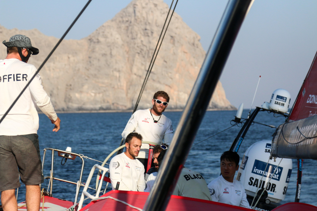 December 12, 2014. Leg 2 onboard Dongfeng Race Team. South of Mussandam, North of Oman; Charles Caudrelier on helm.