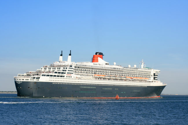 Queen Mary 2 outbound from Southampton 2 Sept 2013 passing the Black Jack navigational buoy at the southern tip of Southampton Water.